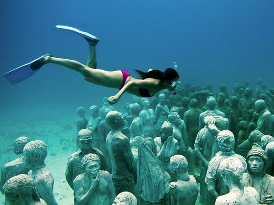 "More than 400 permanent sculptures were installed in late 2010 in the National Marine Park of Cancún, Isla Mujeres, and Punta Nizuc as part of a major artwork called ""The Silent Evolution."" The installation is the first endeavor of a new underwater museum called MUSA, or Museo Subacuático de Arte."