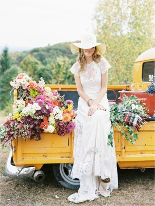 Truck full of flowers and a bride in leopard print shoes