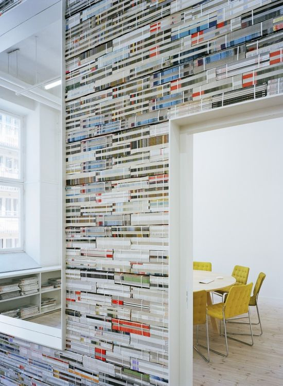 elevator lobby wall - this idea but with the ends of books, signage painted right onto the book stacks - 8124 D4
