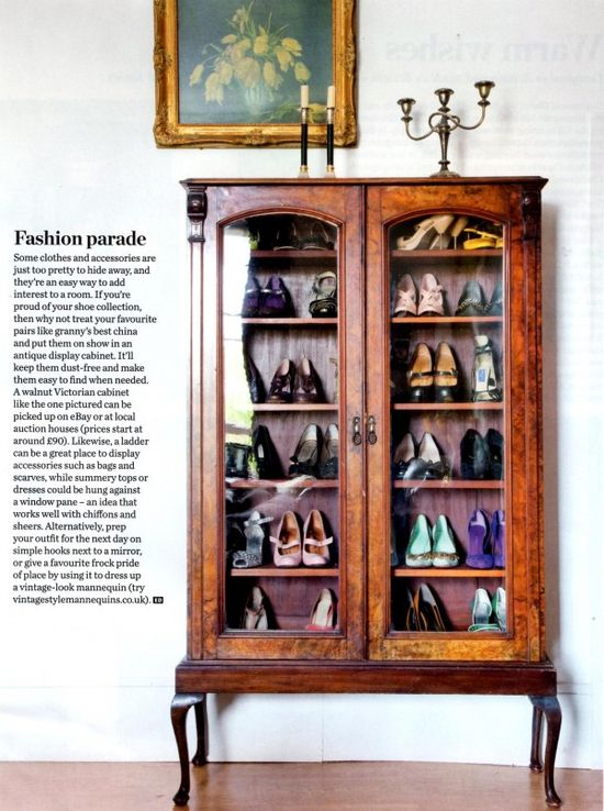 China cabinet being used as a shoe case. I love this cabinet, but think it would look better with vases!