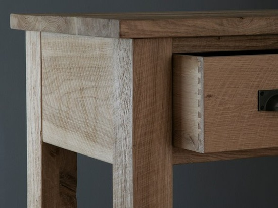 The Riven Oak Console Table is versatile piece of furniture that's as happy in a hallway as it is in a dining or living room. With three drawers handmade with stunning dovetails joints, the oak console table also has a solid oak frame constructed with traditional mortice and tenon joints making this side table able to last a life time. #console #lightwood #oak #wood