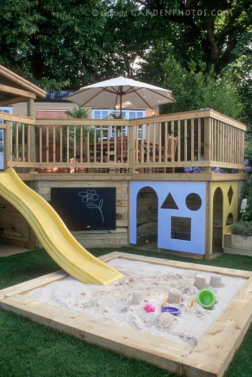 playhouse built under porch with slide into sandbox...AWESOME IDEA!!  great use of space normally wasted!