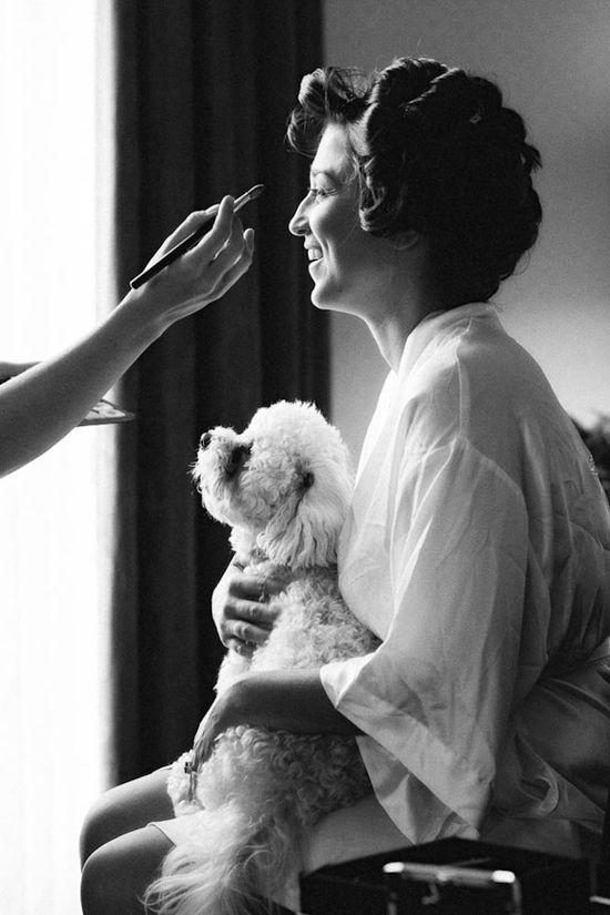 Adorable dog and bride getting ready photo by Holland Photo Arts
