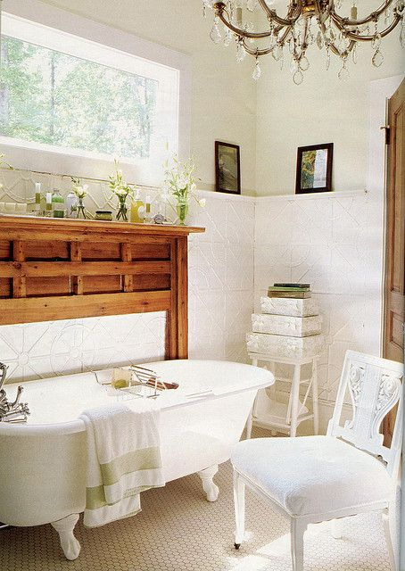 Love all the white with the rich wood mantle // Country Living Magazine September 2004
