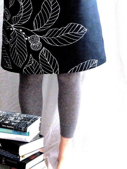 Love the skirt + grey leggings...