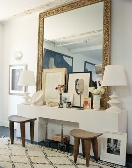 Gorgeous Decor on the fireplace mantel. Love the layering of art & accessories, starting with the over sized beautiful mirror.