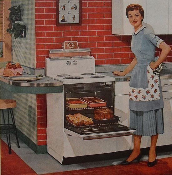 I wonder if she intentionally matched her dress and apron to her kitchen counters? :) #woman #housewife #homemaker #kitchen #stove #oven ##1950s #ad #vintage #fifties #food #retro