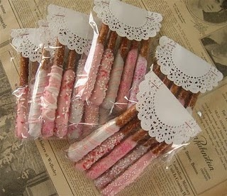 Dipped pretzels in clear packages topped with a doily....cute!!!