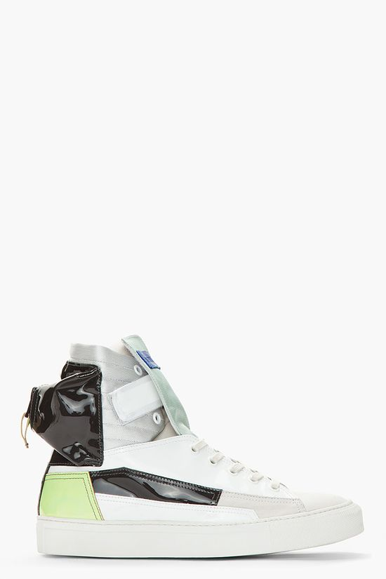 Raf Simons White And Green Patent Leather Astronaut Pocket Sneakers -  Raf Simons White And Green Patent Leather Astronaut Pocket Sneakers Raf Simons High top patent leather sneakers in white. Round toe. Off_white lace up closure with white eyelets. Foldover tonal patent leather velcro closure at ankle. Contrast textile tongue in mint with royal blue leather logo...