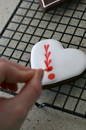 Very cute way to put hearts on cookies!