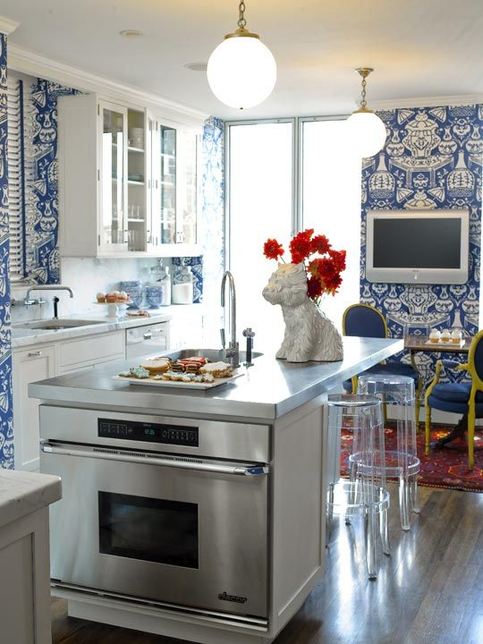 Blue and white wallpaper packs a visual punch in this lovely kitchen. Traditional Home®