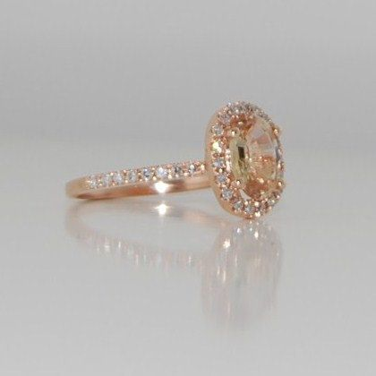 oval champagne peach sapphire diamond ring in rose gold.
