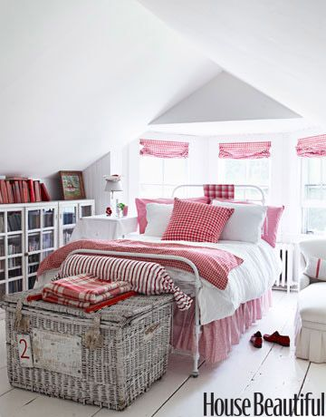Red and White Guest Room  When decorating the guest bedroom of her house in Bridgehampton, NY, design consultant Ellen O'Neill picked out vintage red-checked bedding from a Paris flea market. It echoes the red-checked window-shade fabric from Ralph Lauren. Antique wicker hamper from Bloom. Iron bed from English Country Antiques.