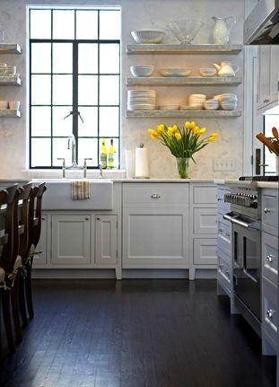 marble floating shelves, espresso wood floors, steel windows, & farmhouse sink
