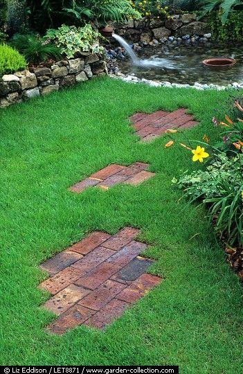 Decorative brick path across lawn