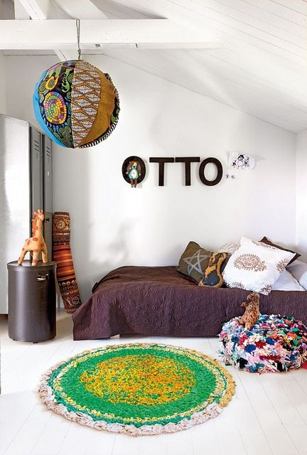 """We'd want a more colorful """"girly"""" feel, but I like the low bed and area rug idea...."""