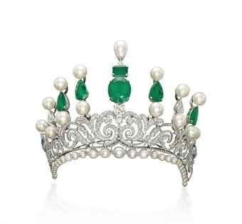 AN IMPRESSIVE EMERALD, NATURAL PEARL, CULTURED PEARL AND DIAMOND TIARA The Belle Epoque diamond-set scroll tapering bandeau on a later added base of graduated cultured and natural pearls with diamond rondelle spacers, to the later added graduated bar surmount set with cultured and natural pearls, emeralds and diamonds, inner diameter 14.5 cm