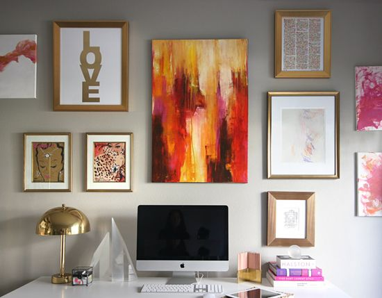 Gallery inspiration: All the art and frames are different but are tied together with a similar colour scheme.  We love the warm gold and red hues! #gallery #art #frames #LaDolceVitaBlog