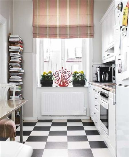 Great inspiration for tiny galley kitchens like mine. Love the blinds and book rack