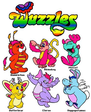 I recently found a figurine of that little yellow guy in the corner at my mom's house, and I couldn't for the life of me remember what it was. Now I remember! Wuzzles!