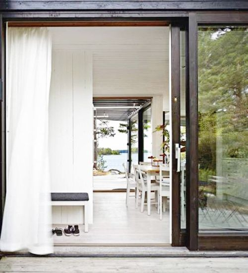 love the dark frame on this large, airy patio door!