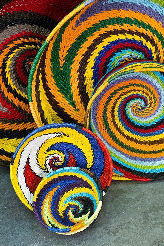 Vibrant handmade paper baskets from Earthbound. Talk about an awesome pop of color in your