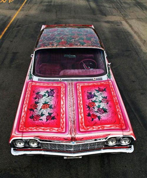 gorgeous paint job on this lowrider-- This is crazy but Bill had a white Mustang with red and a paisley top, yep 1969..he didn't have it long..too costly and I think he may have burned out the trannie or something ;)