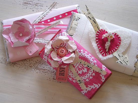 Valentines: candy bars wrapped in assorted papers and decorated with sweet flowers and hearts.