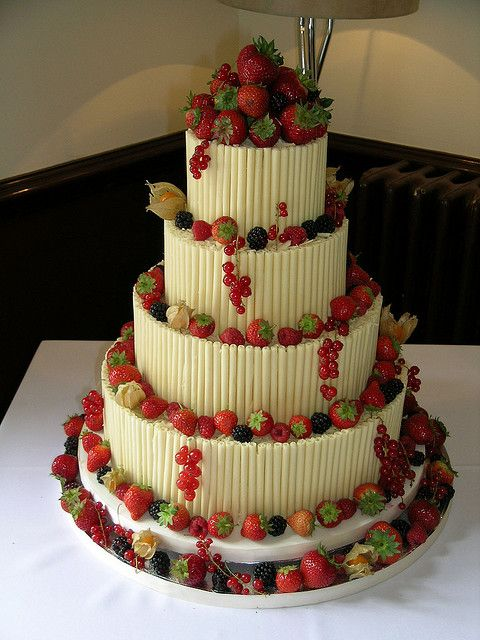 White chocolate wedding cake with fresh berries and fruit