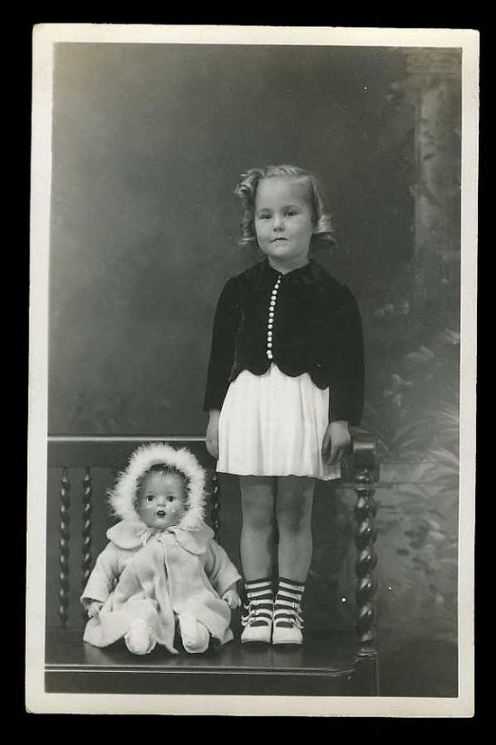 Wonderful vintage photo of a little girl with her doll circa 1940's - 1950's.