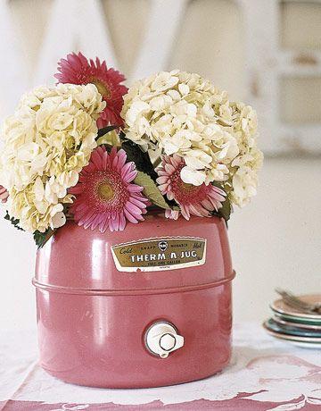 repurposing an old thermos jug into a vase