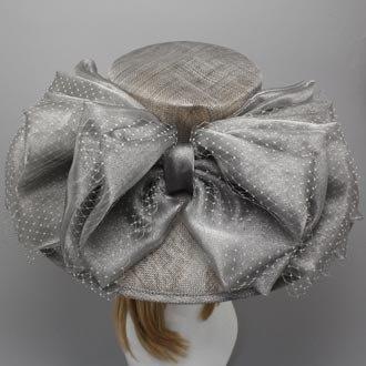 Derby Hat Kentucky Derby Hat Dress Hat Bow Sinamay Hat Church Hat Wide Brim Hat Dress Hat Bridal Wedding Tea Party Ascot Fashion Sun Hat. $89.95, via Etsy.