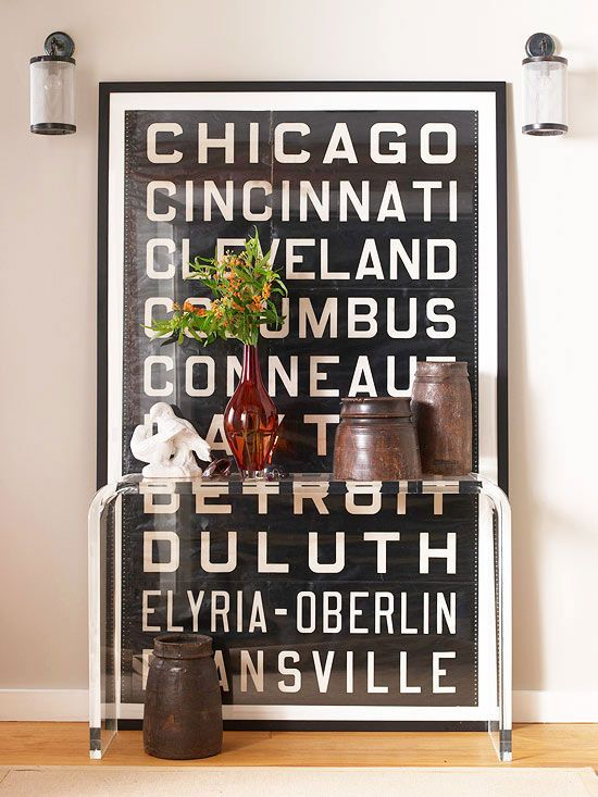 Oversized typography artwork adds a modern touch. Find 35 more blank wall solutions: www.bhg.com/...