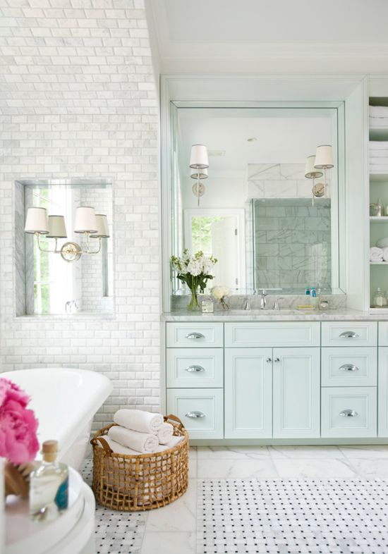 Mint cabinetry, mirrored niche, mix of basket weave, & marble