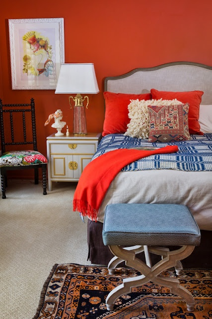 orange walls bedroom blue oriental rug white campaign nightstand