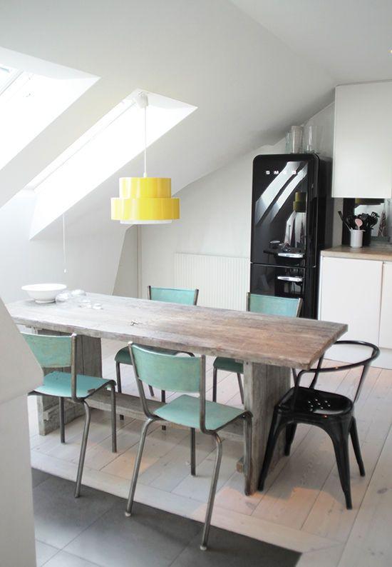 mismatched chairs, smeg fridge, yellow light