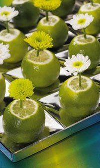 Great idea to add color to any table setting! Could also use lemons and instead of a flower, use a toothpick and name card for cute place settings