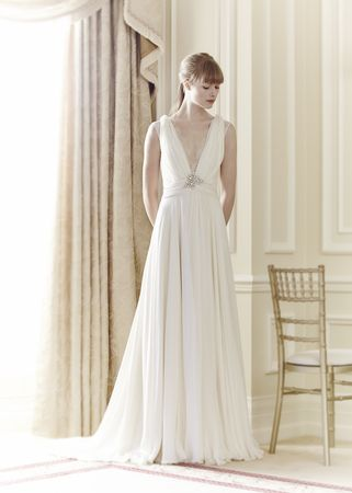 A romantic wedding gown with a plunging neckline in the Jenny Packham Spring 2014 collection.