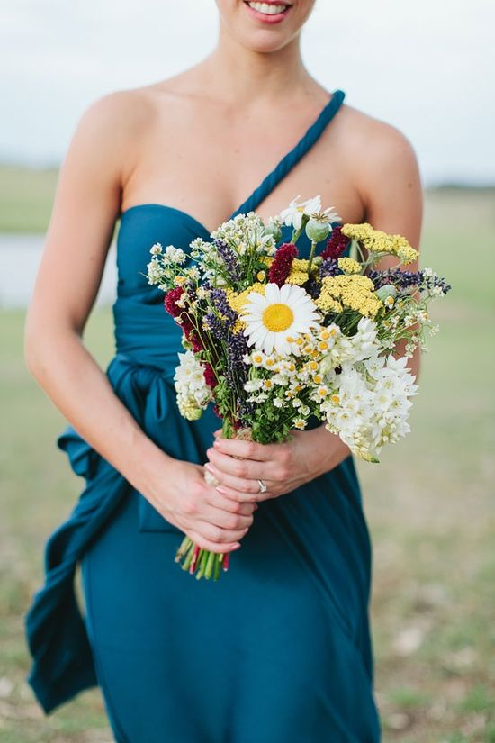white and yellow wildflower wedding bouquet with red and purple accents
