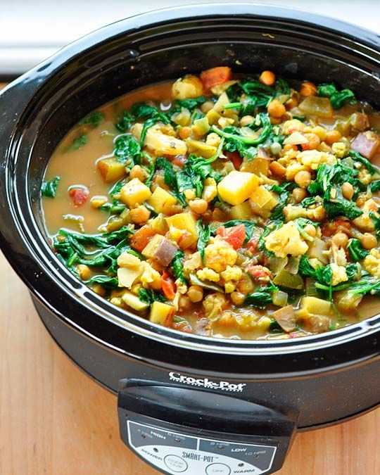Soooooo good. Curried vegetable and chick pea stoup. Make again. used 2 sweet potatoes, only 5 oz spinach, and cooked on low for 8 hrs.  Ohhhh and I skipped the prep on the stove part....  Just put it all in the crockpot raw. Served over orzo.