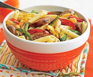 Italian dressing mix is tossed with hot pasta then mixed with freshly grilled vegetables and hot Italian sausage to make this colorful main dish.