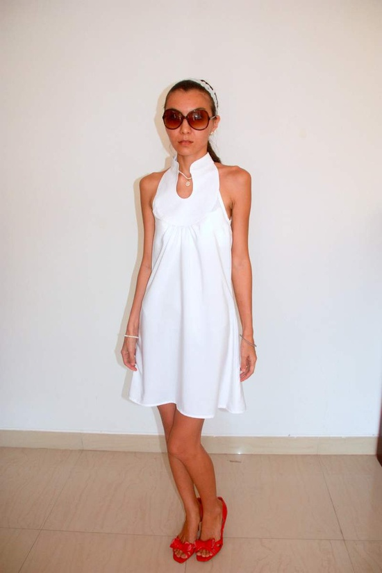 White mini sleeveless dress with stand collar. $38.00, via Etsy.