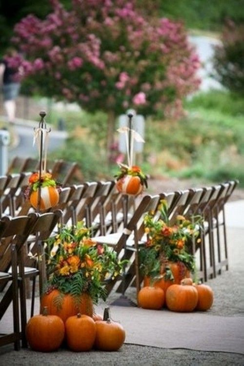 Great for a fall wedding ~ Fall flowers in a pumpkin as a vase...great idea for aisle
