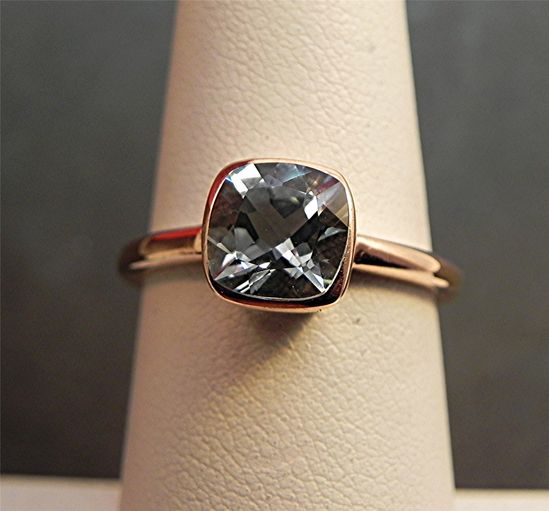 AAA 7x7mm Cushion Cut Natural Untreated Blue Aquamarine  1.22 carats in a 14K Rose gold Engagement ring.. $575.00, via Etsy.