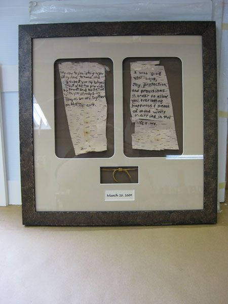 I am totally doing this! handwritten vows framed side by side so you can keep them and remember what you promised one another :) There is also a knot tied at the bottom with the date.