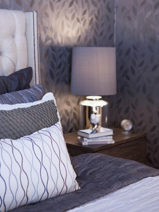 """To make a room feel warmer, try painting the ceiling, trim and doors all the same color. In this room, Benjamin Moore's """"Fusion"""" is used. Patterned wallpaper adds movement, while silvery tones keep it from getting too dark. An extra tall headboard is great for bedrooms with high ceilings. Photographer Marija Vidal"""