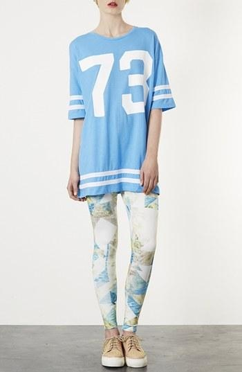 Style tip: Dress up a jersey with print leggings.