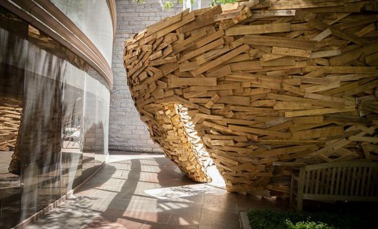 The Reading Nest: A New Installation by Mark Reigelman Using 10,000 Reclaimed Boards  wood nests installation architecture