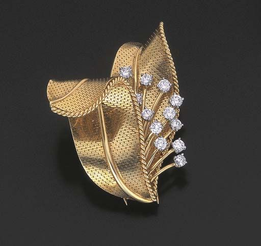 A DIAMOND AND GOLD FLOWER BROOCH, BY CARTIER, signed Cartier, Paris