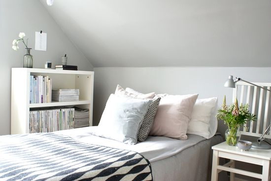 Simple bedroom corner. Love the idea of a chair as bedside table!